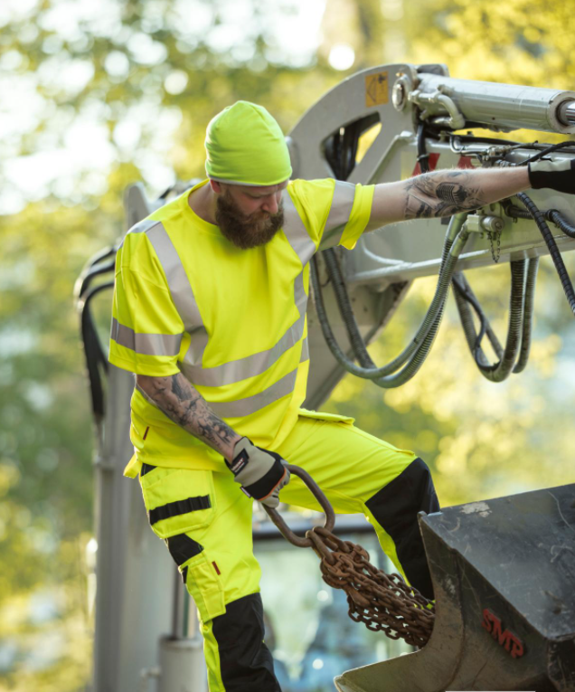 Man standing on the stains on heavy machinery